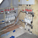 Downstairs underfloor heating manifold