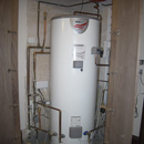 300L megaflow hot water cylinder installed in hall cupboard in Central London