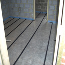 Insulated flooring with grip laid for pipework