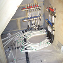 Underfloor Heating System Manifold attached to pipework - labelled with areas